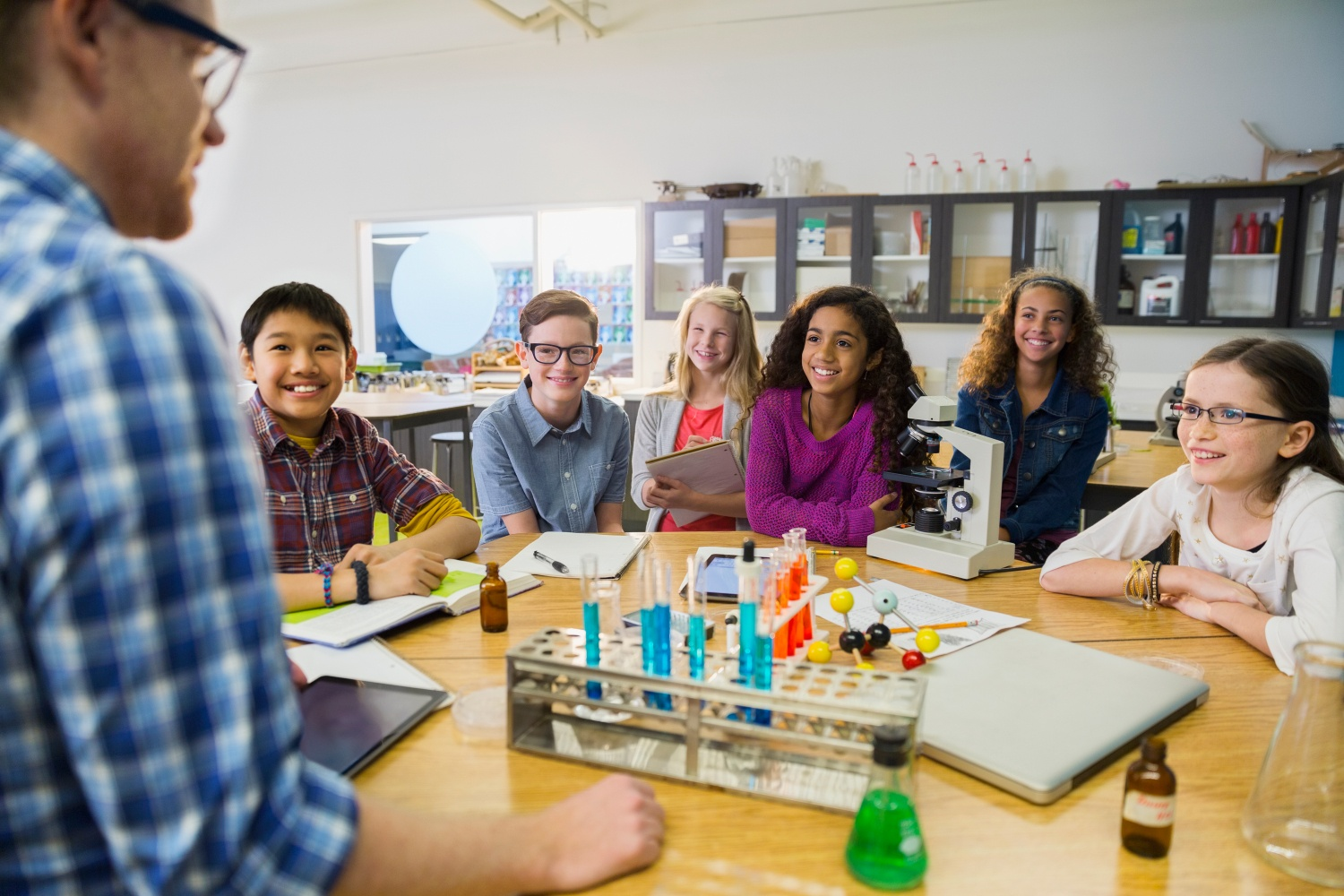 stock-photo-teacher-and-elementary-students-in-laboratory-95113937.jpg